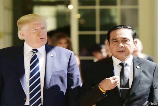 影響力のある米国に対し、タイは良好な関係を維持(写真右はプラユット暫定首相)